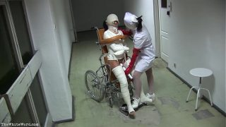 Patient in Wheelchair with Broken Legs and Straitjacket – TheWhiteWard.com